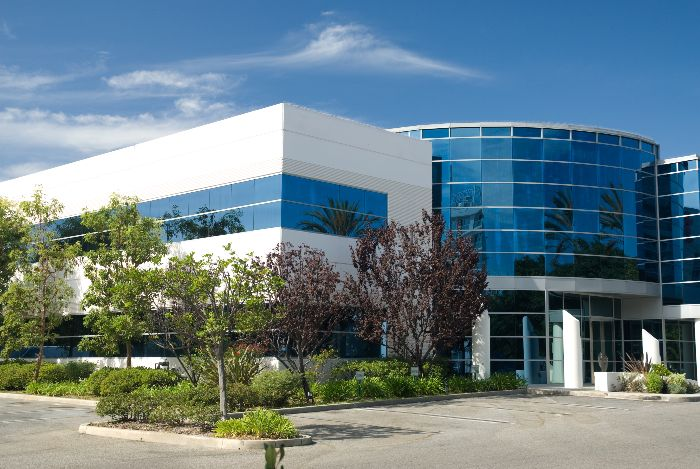 office building exterior with landscaping