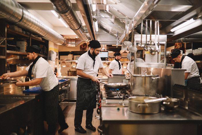 restaurant kitchen with chefs cooking