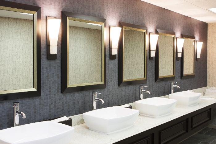 row of sinks in a restaurant bathroom