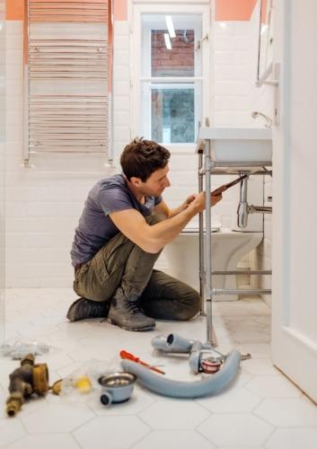 Man Fixing Sink Plumbing